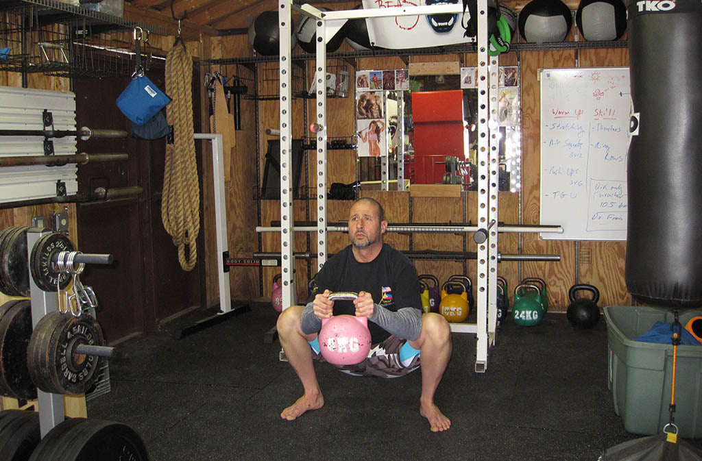 man in goblet squat