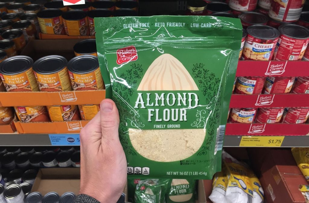hand holding a package of almond flour