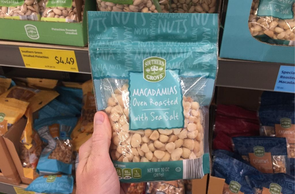 man's hand holding a bag of macadamia nuts
