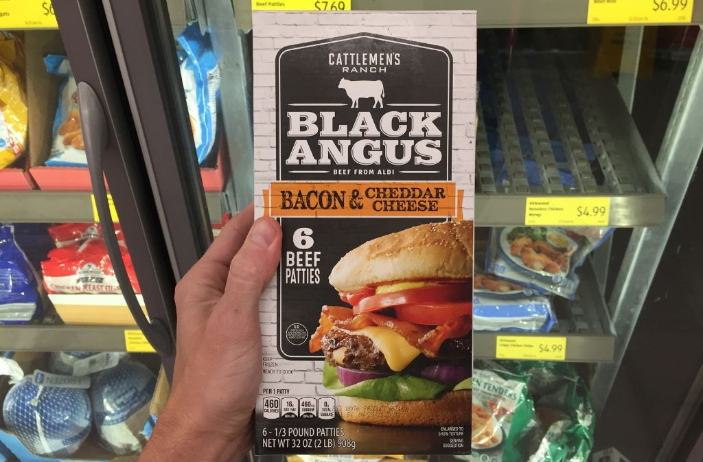 hand holding a package black angus burgers