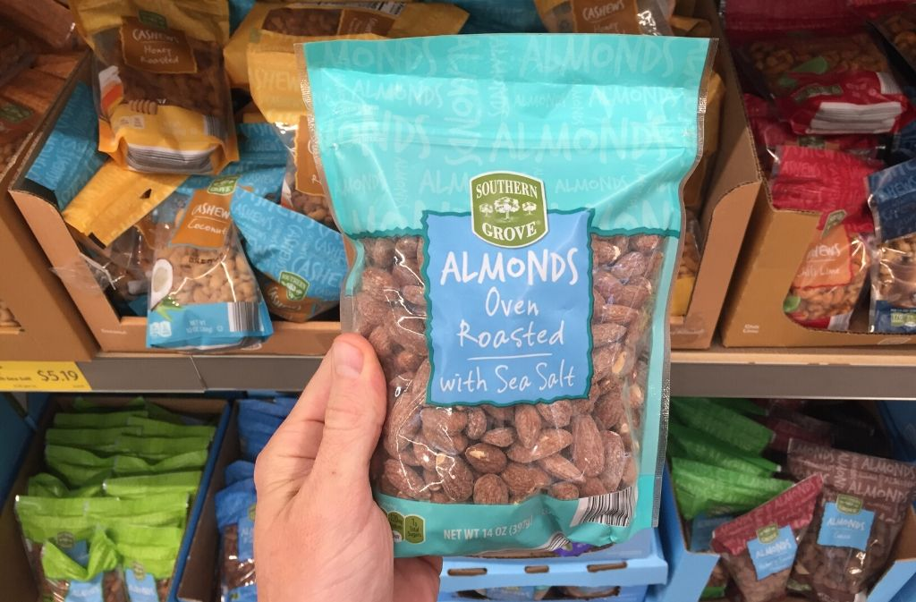 hand holding a bag of almonds