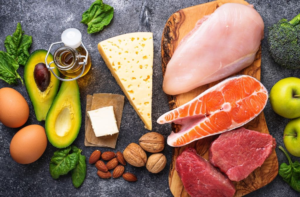 avocado, cheese, salmon, nuts, eggs, and other foods to include on a keto shopping list