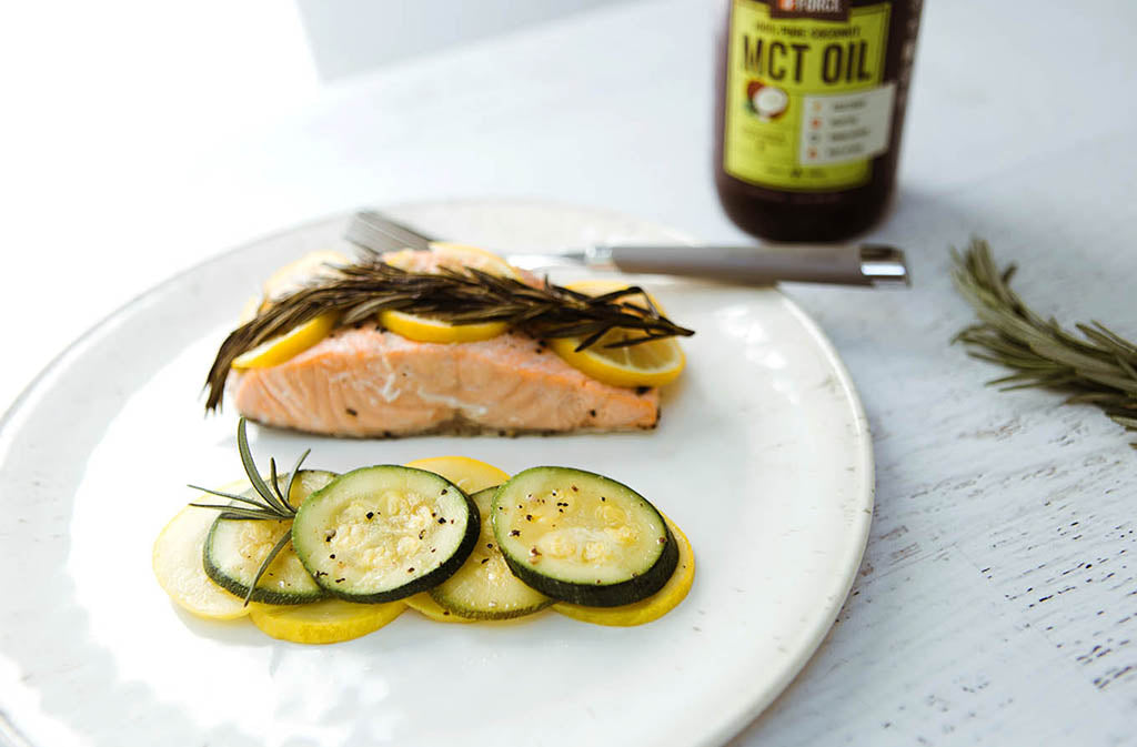 plate with baked salmon and sliced zucchini and squash