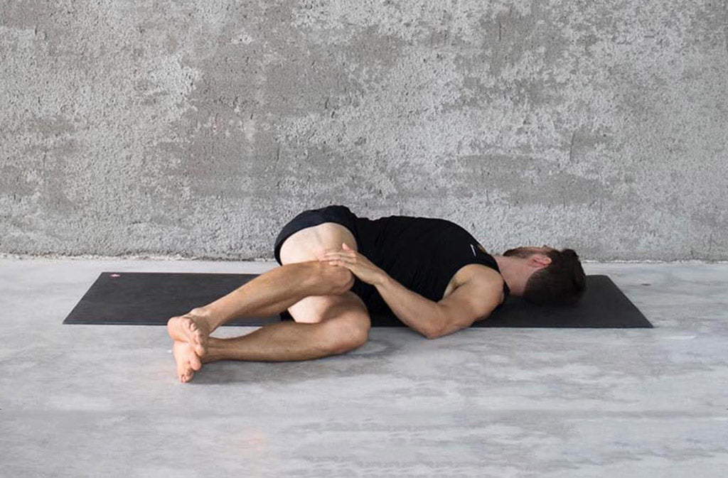 man in yoga pose