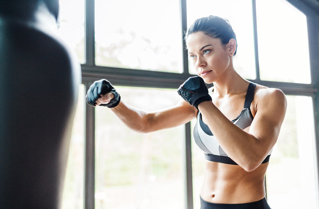 woman boxing with a punching bag
