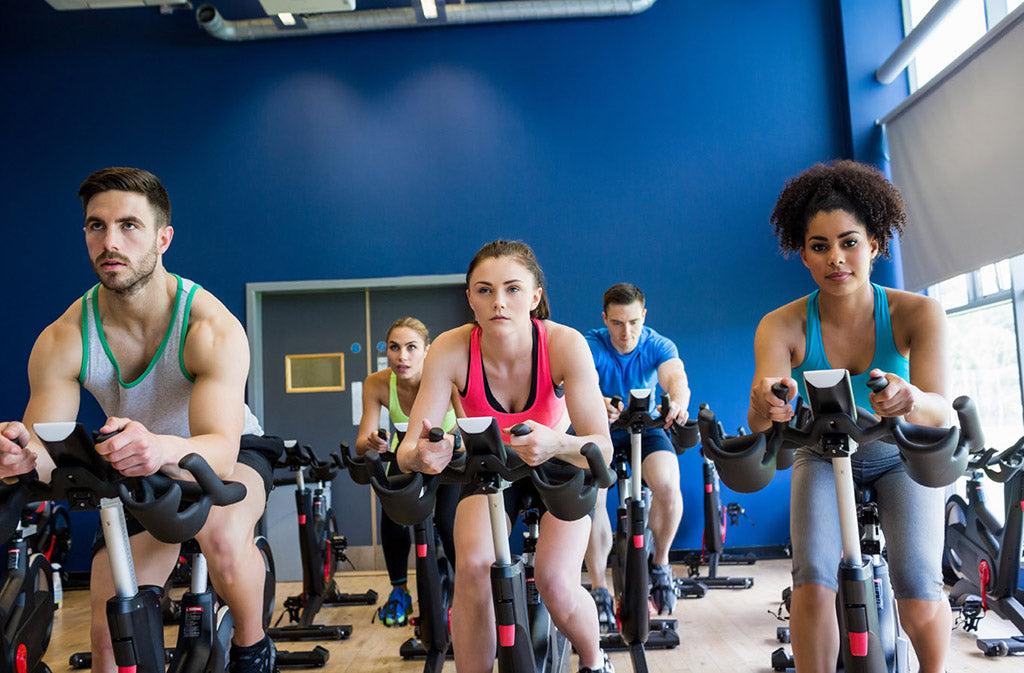 people in a spin cycling class
