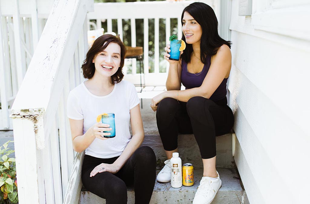two women laughing drinking keto coconut creamsicle italian sodas