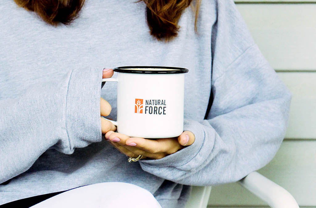 woman holding a Natural Force mug - not losing weight on keto
