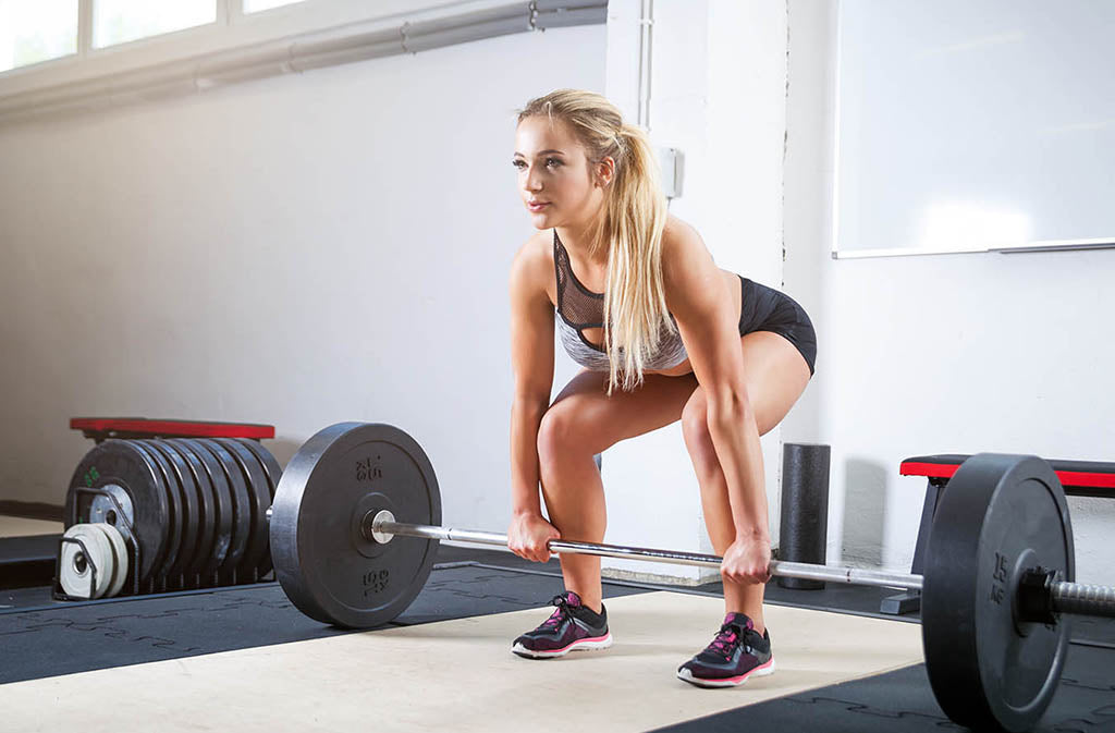blond athletic woman ready to deadlift