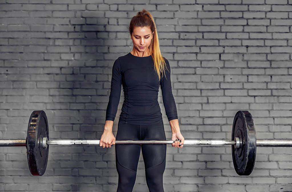 athletic woman holding a barbell