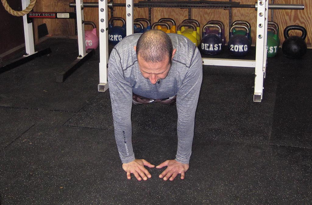 man in close grip push up position