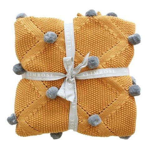Unisex Baby Blanket Pom Pom Knit Butterscotch. Shop online or in store at Sticky Fingers Children's Boutique, Niddrie, Melbourne.