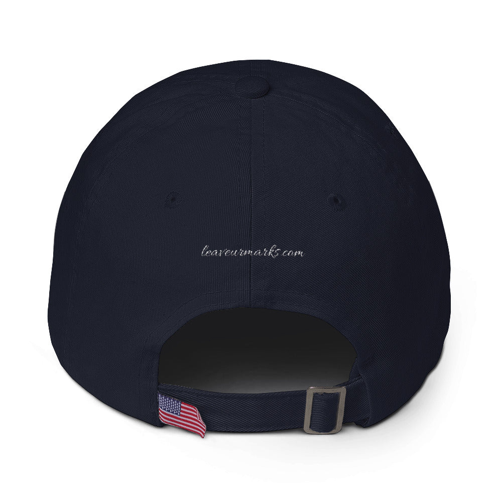 "The back of a black ""Be confident"" baseball cap with hats inspirational quotes and the Leave Ur Marks URL"