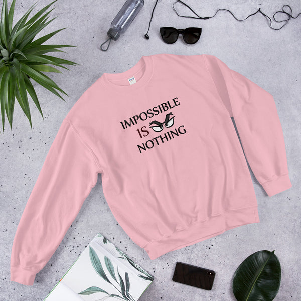 "A light pink motivational quotes clothing sweatshirt that says, ""Impossible Is Nothing"""