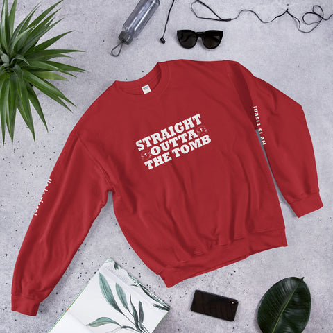"A beautiful red Christian inspirational clothing sweatshirt that says ""Straight Outta the Tomb"""