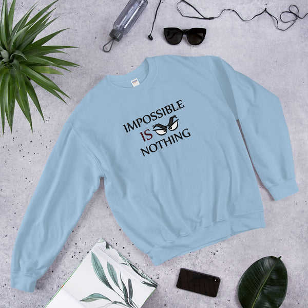 "A light blue motivational quotes clothing sweatshirt that says, ""Impossible Is Nothing"""