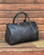 Ashwood leather holdall brown on wooden background back angle