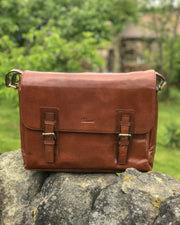 Ashwood jasper leather satchel messanger bag on stone wall chesnut front