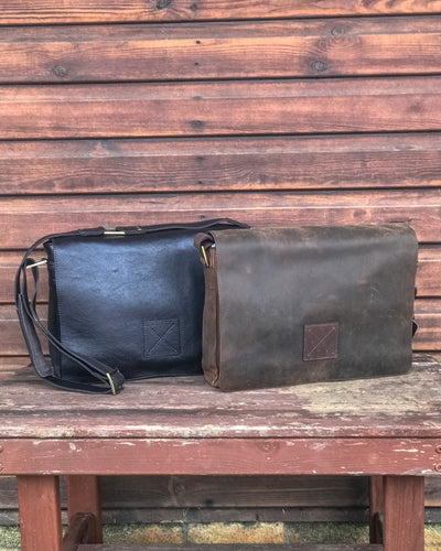 Ashwood collection of leather messenger bags brown mud on wooden bench