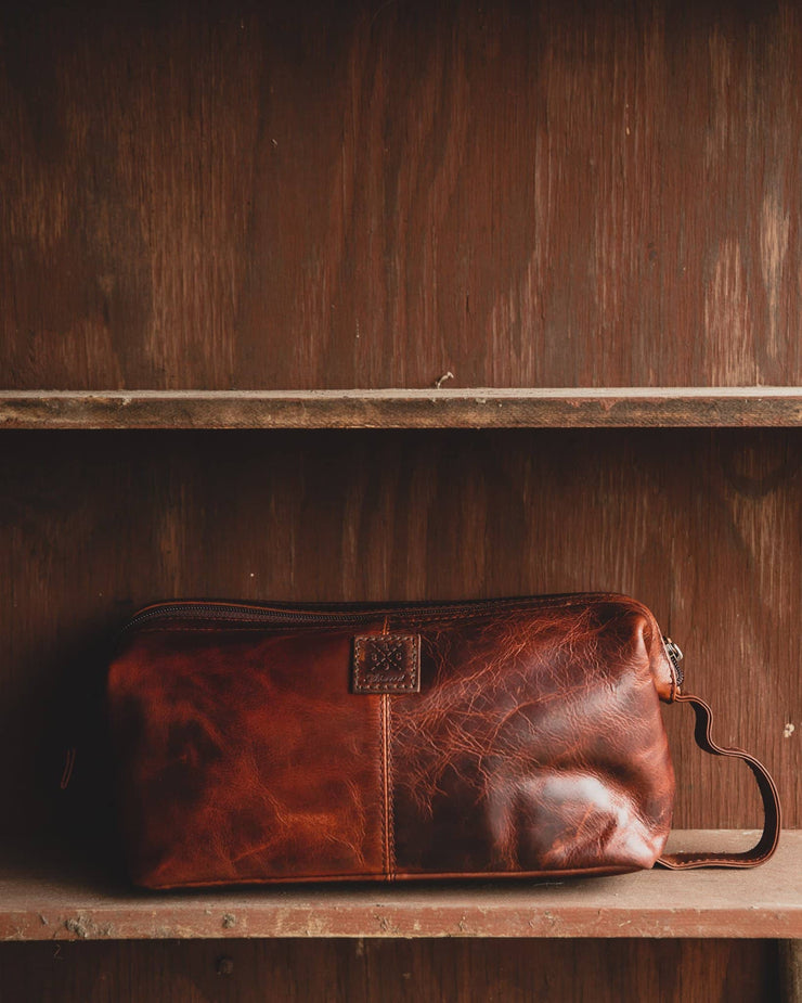 Ashwood wash bag seb on Wooden Shelf vintage tan