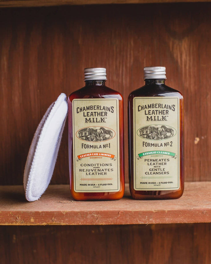 Chamberlains Leather Milk Pack of Lintment 1 and 2 on wooden shelf with pad