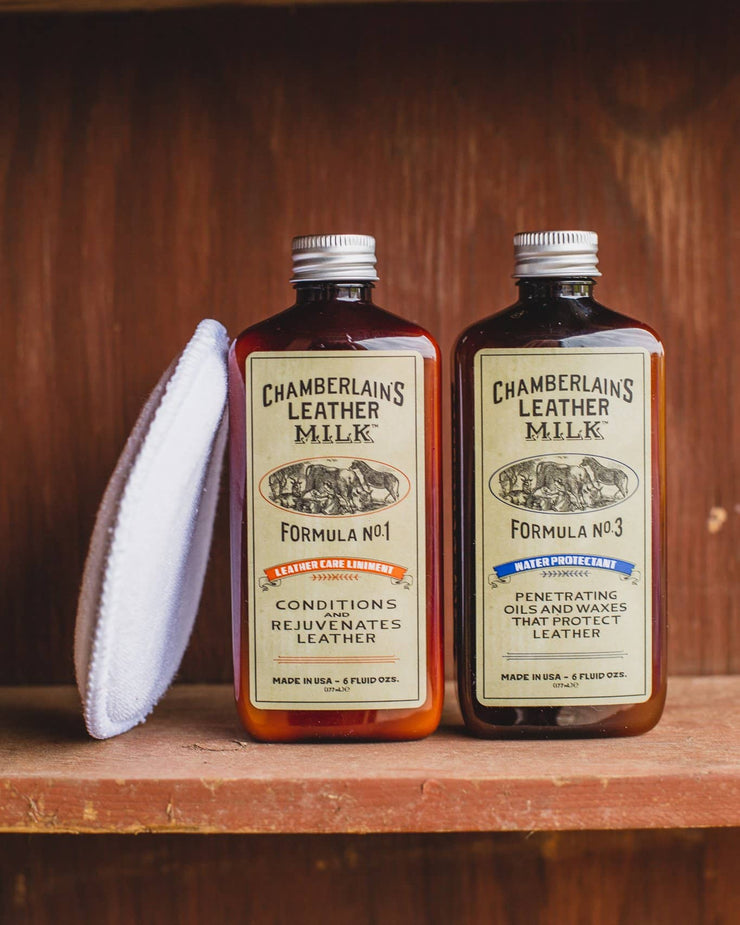 Chamberlains Leather Milk Pack of Lintment 1 and 3 on wooden shelf with pad