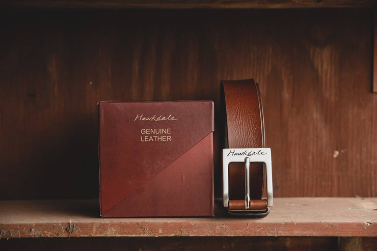 Hawkdale mens leather belt 811-400 brown on wooden shelf