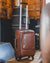 Nordvek trolley suitcase in room with wooden floor in front of fire tan 101-100