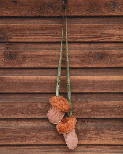 Kids Nordvek sheepskin puddy mittens 303-100 chesnut with green ribbon hanging on stables
