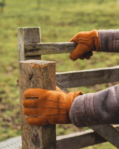 Mens Nordvek sheepskin chestnut gloves opening wooden gate in field 306-100