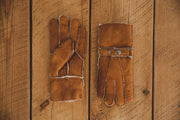 Nordvek Mens 307-100 sheepskin chestnut gloves on wooden background