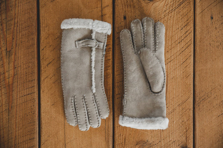 Nordvek womens sheepskin beige gloves on wooden background