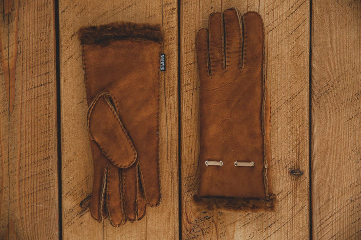 Nordvek womens sheepskin gloves 317-100 autumnal brown side by side on wood background
