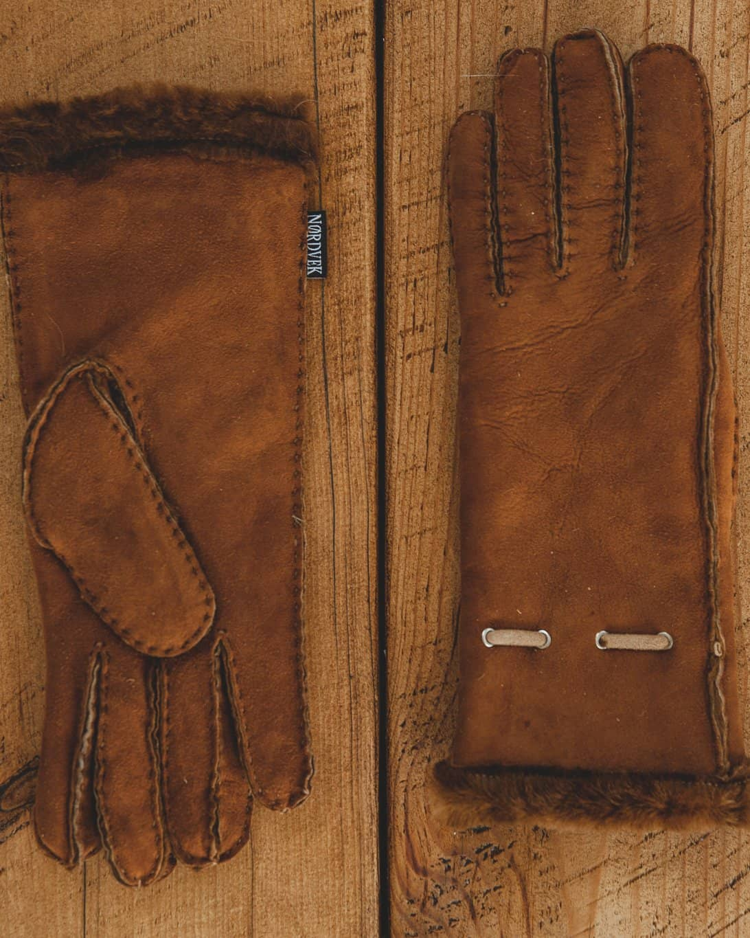 Nordvek womens sheepskin gloves 317-100 autumnal brown on model sat on wall