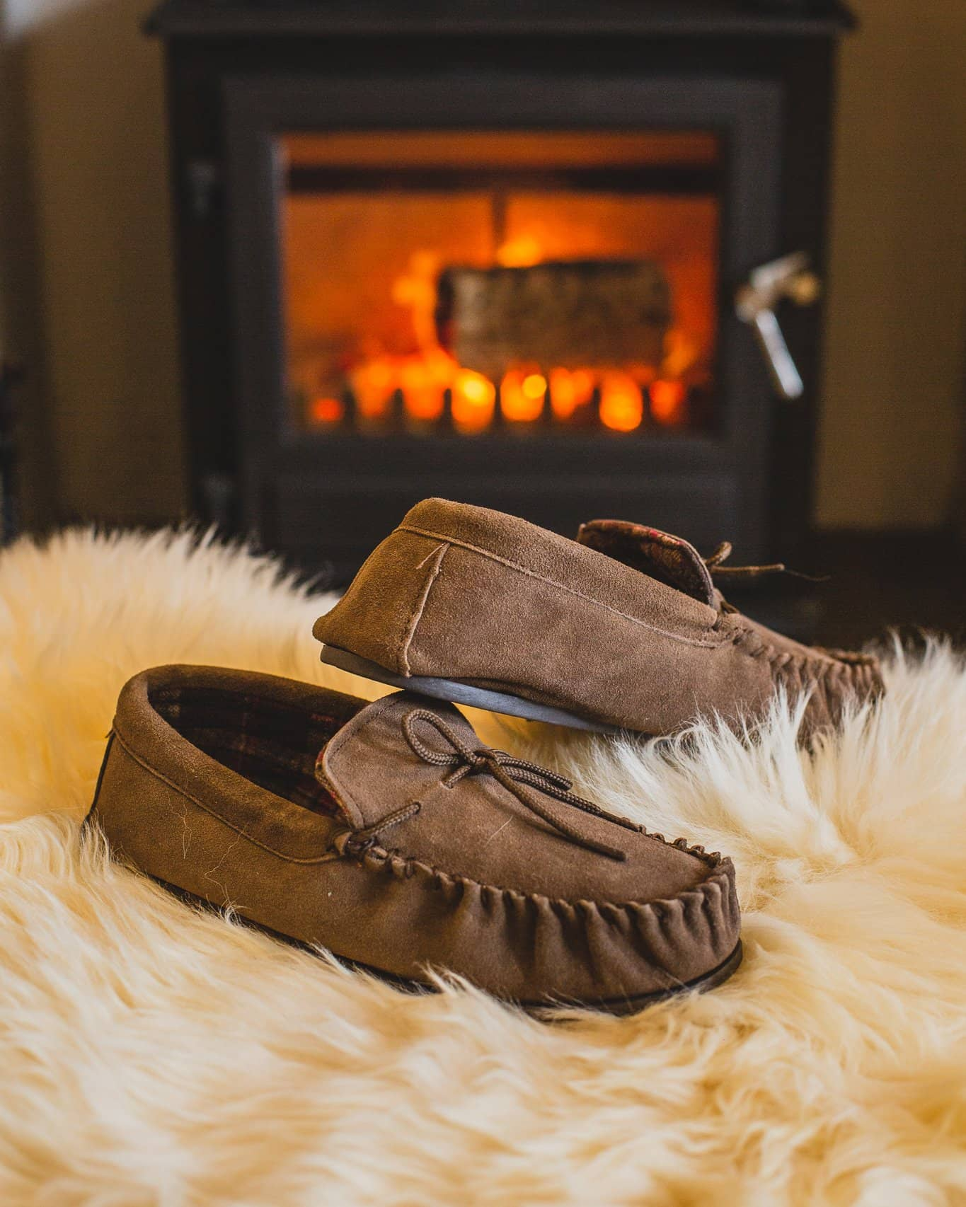 Nordvek mens moccasins hard sole  424-100 taupe in front of fire on pouffe