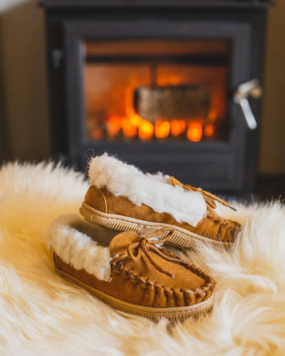 Nordvek kids sheepskin moccasins 435-100 chestnut on rug