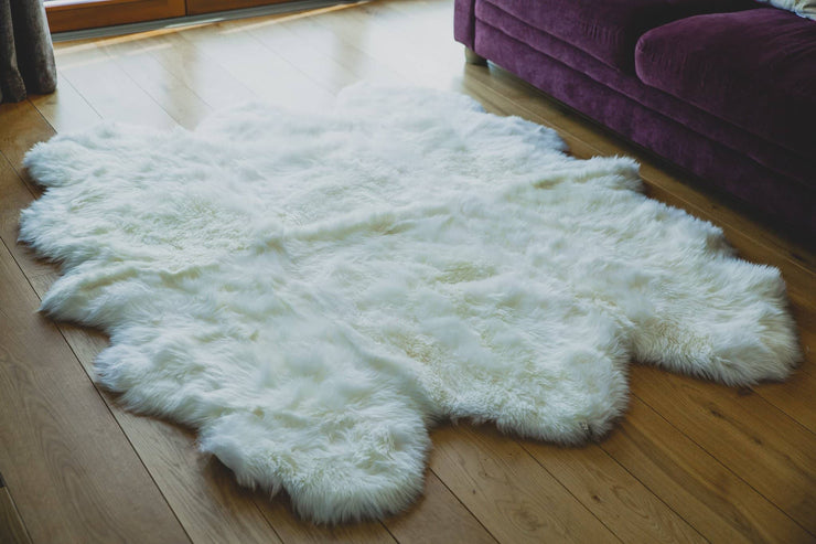 Nordvek sheepskin  natural rug 605-100 sexto in front of sofa close up