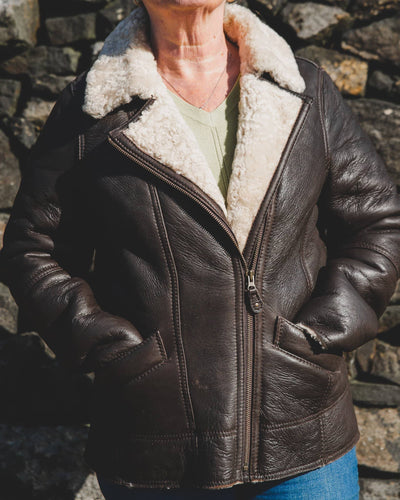 Nordvek womens sheepkin jacket 705-100 front on model stood infront of wall