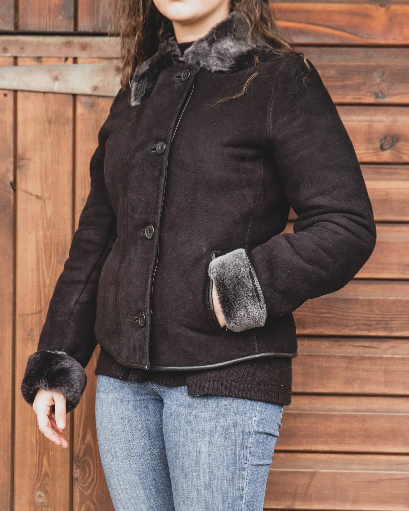 Nordvek womens sheepskin jacket 706-100 black front on model stood infront of stable