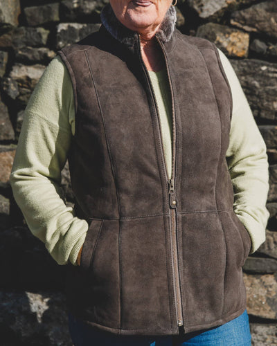 Nordvek womens sheepskin gilet 711-100 stone front in front of stone wall