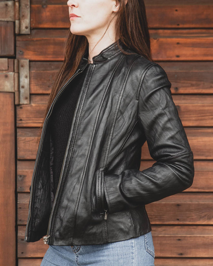 Nordvek womens leather jacket 714-100 black turned to side against stable door