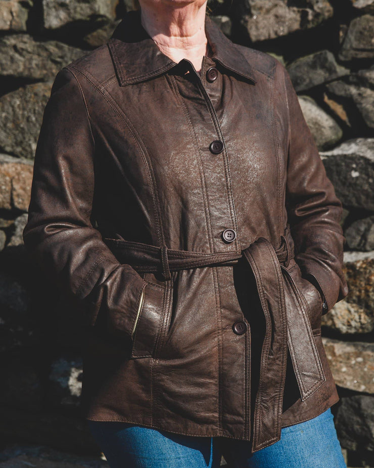 womens leather jacket 715-100 chocolate on model front tied against stone wall