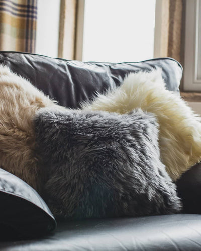 Nordvek sheepskin cushion 9001-100 group on sofa