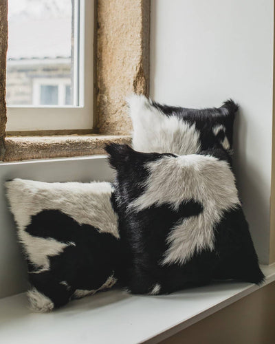 Nordvek cowhide cushion group shot on window sill 9007-100