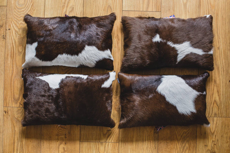 Nordvek cowhide cushion black on wooden floor 9008-100