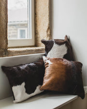 Nordvek cowhide cushion group shot on window sill 9008-100