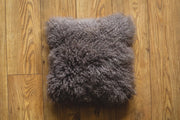 Nordvek mongolian sheepskin cushion 9013-100 grey on wooden floor