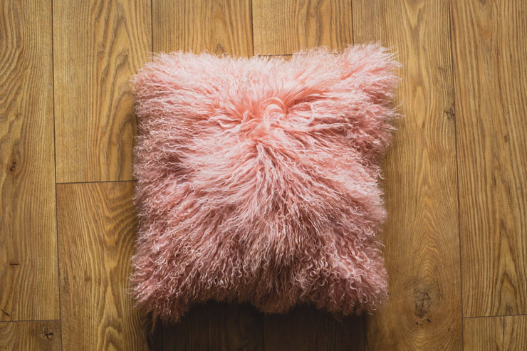 Nordvek mongolian sheepskin cushion 9013-100 pink on wooden floor