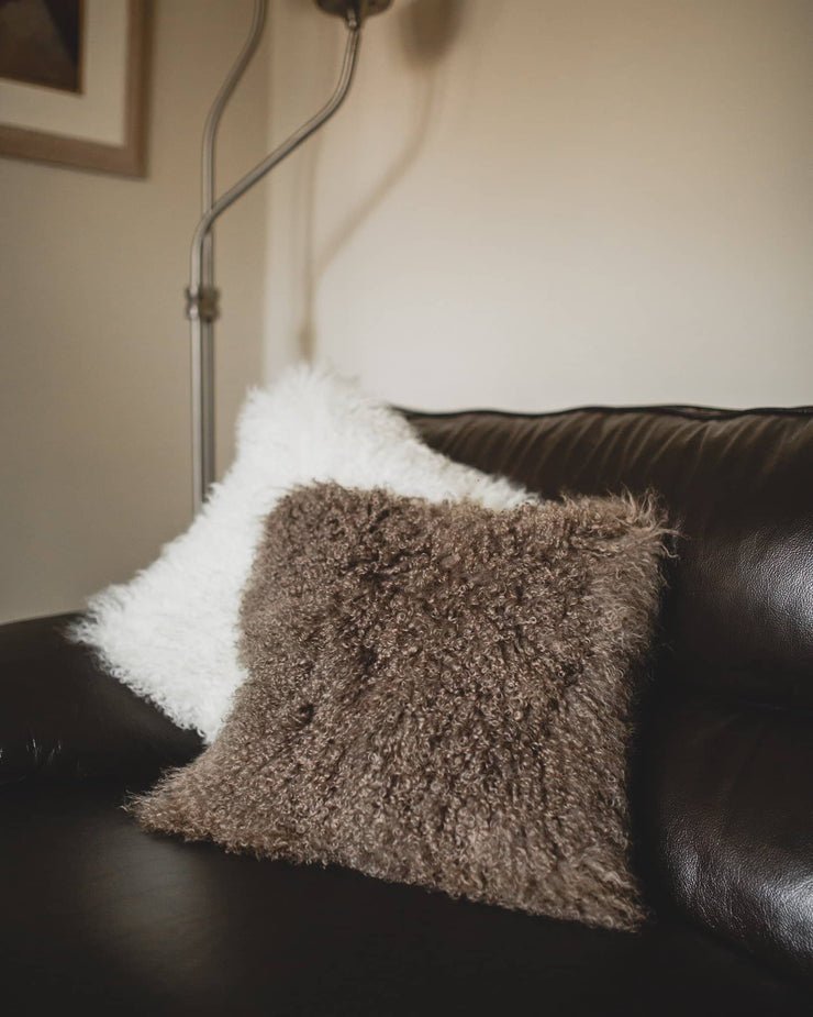 Nordvek mongolian sheepskin cushion 9013-100 group on sofa