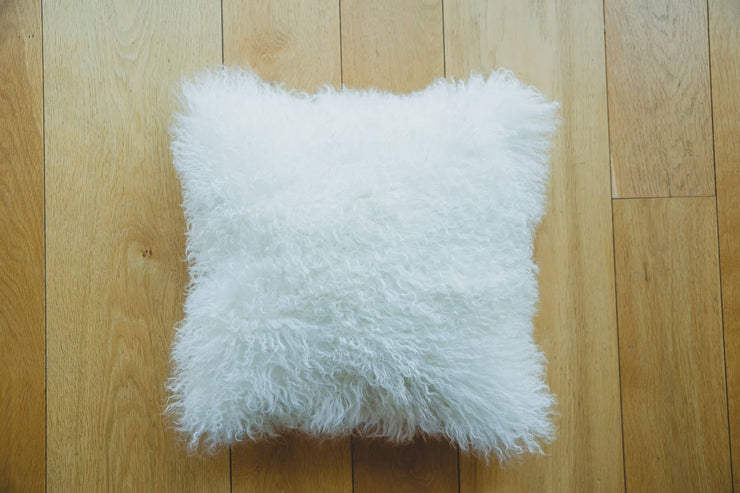 Nordvek mongolian sheepskin cushion 9013-100 white on wooden floor